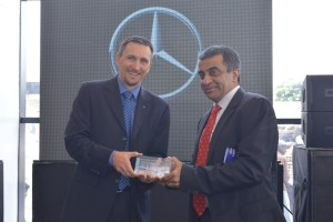 Boris Fitz, Vice President, Sales and Network Development, Mercedes-Benz India hands over the memento to Mohan Mariwala, Managing Director, Auto Hangar Raipur a
