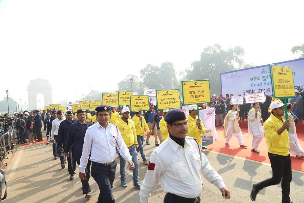 JK Tyre volunteers and Delhi Traffic Police at Road Safety Walk to celebrate the National Road Safety Week in Delhi on Monday