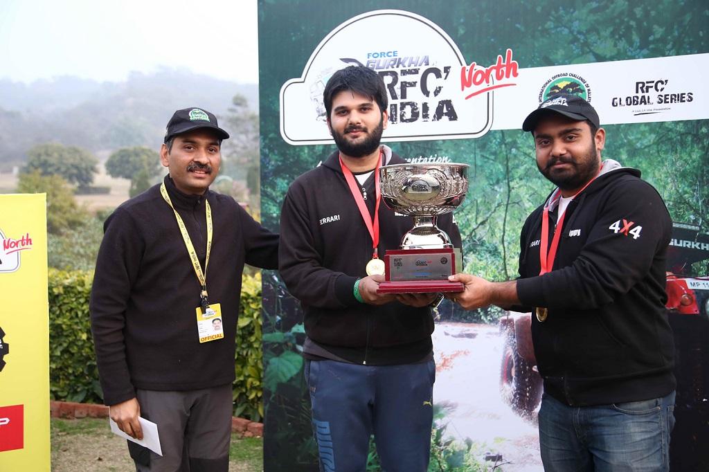 (L-R) Cougar Motorsport's Ashish Gupta handing over the Force Gurkha RFC North India 2016 winners' trophy to Harpreet Singh and Tejinder Pal Singh