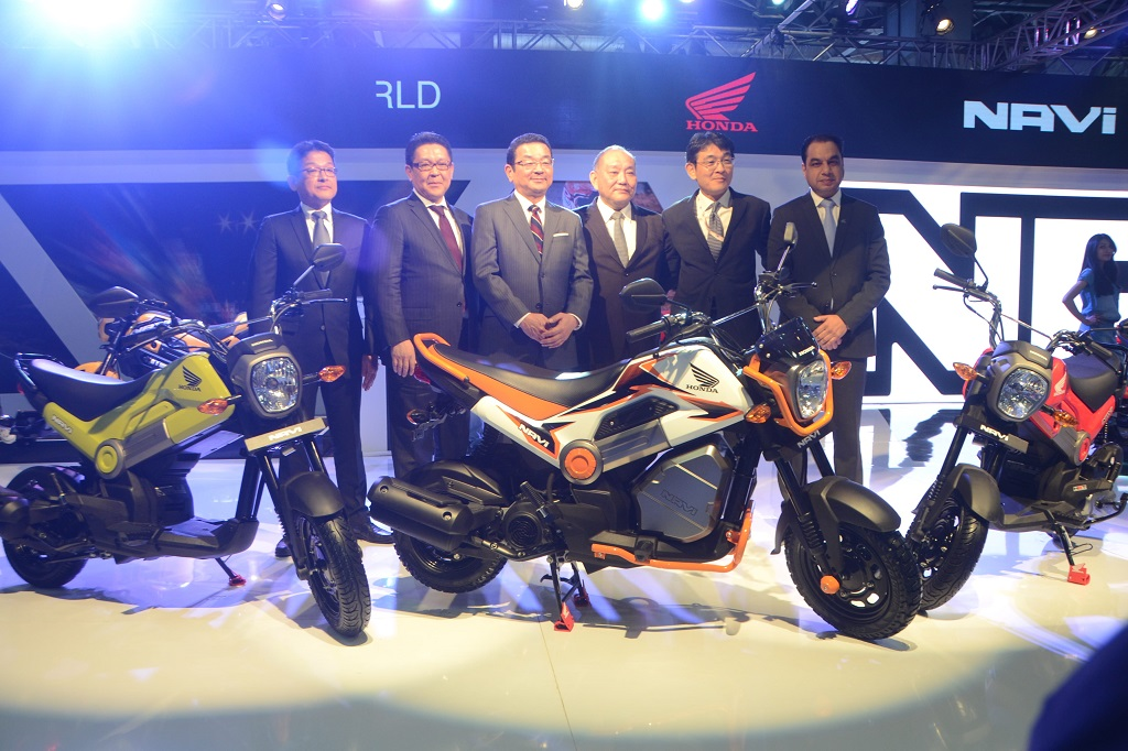 Officials from Honda Motorcycle & Scooter India Pvt. Ltd. Launching NAVI at the AUTO EXPO 2016