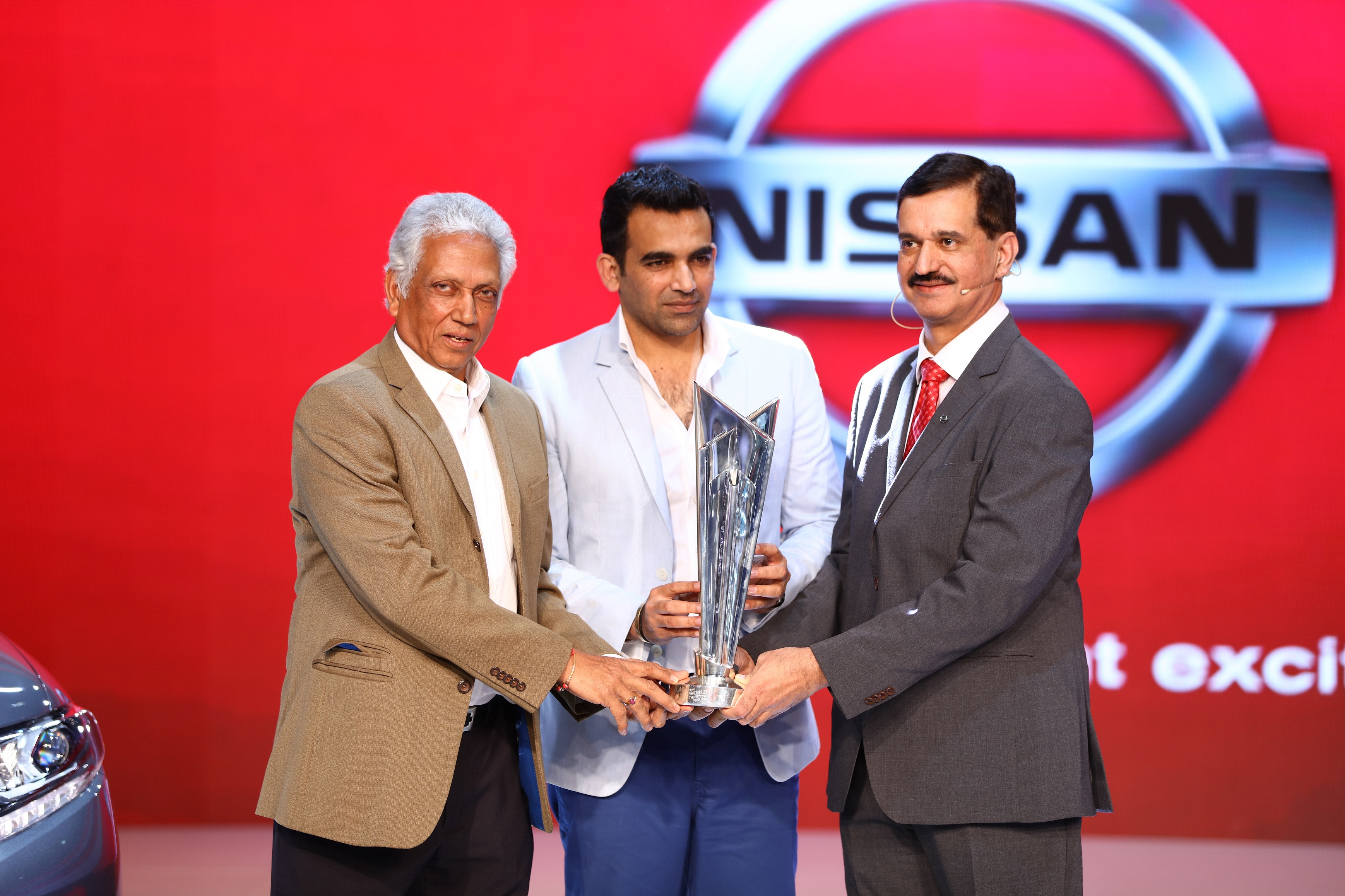 Picture 1 - 1983 WC hero Mohinder Amarnath, Former pace bowler Zaheer Khan and Arun Malhotra, Managing Director, Nissan Motor India PVT. Ltd.