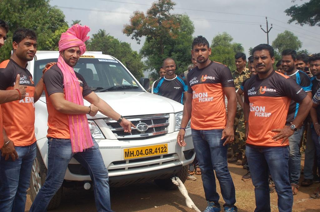 Team U Mumba pose with Tata Motors_ Xenon during the inaugural ceremony ...