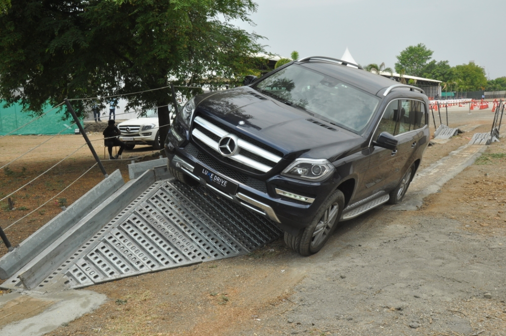 Expert drivers showcasing the various vehicle dynamics and features of the Mercedes-Benz