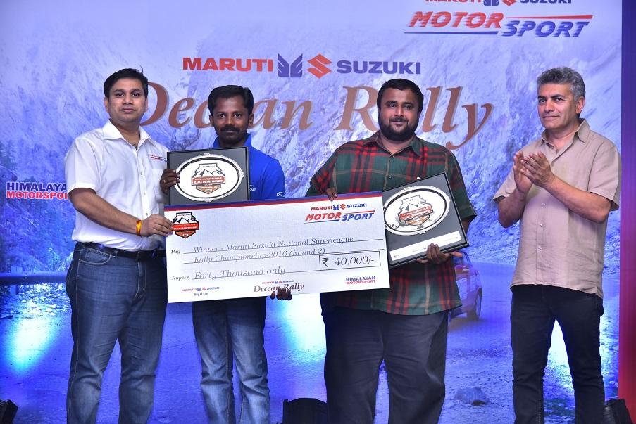 Maruti Suzuki Deccan Rally winners Karthick Maruti and S Sankar Anand being rewarded by Mr. Amit Kamat, Maruti Suzuki Regional Manager (West)