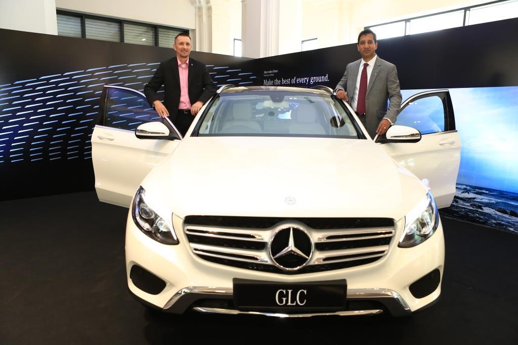 Mr  Boris Fitz Vice President Sales and Network Development Mercedes-Benz India and Arun Surendra Managing Director Titanium Motors launching the Mercedes-Benz GLC  (003)