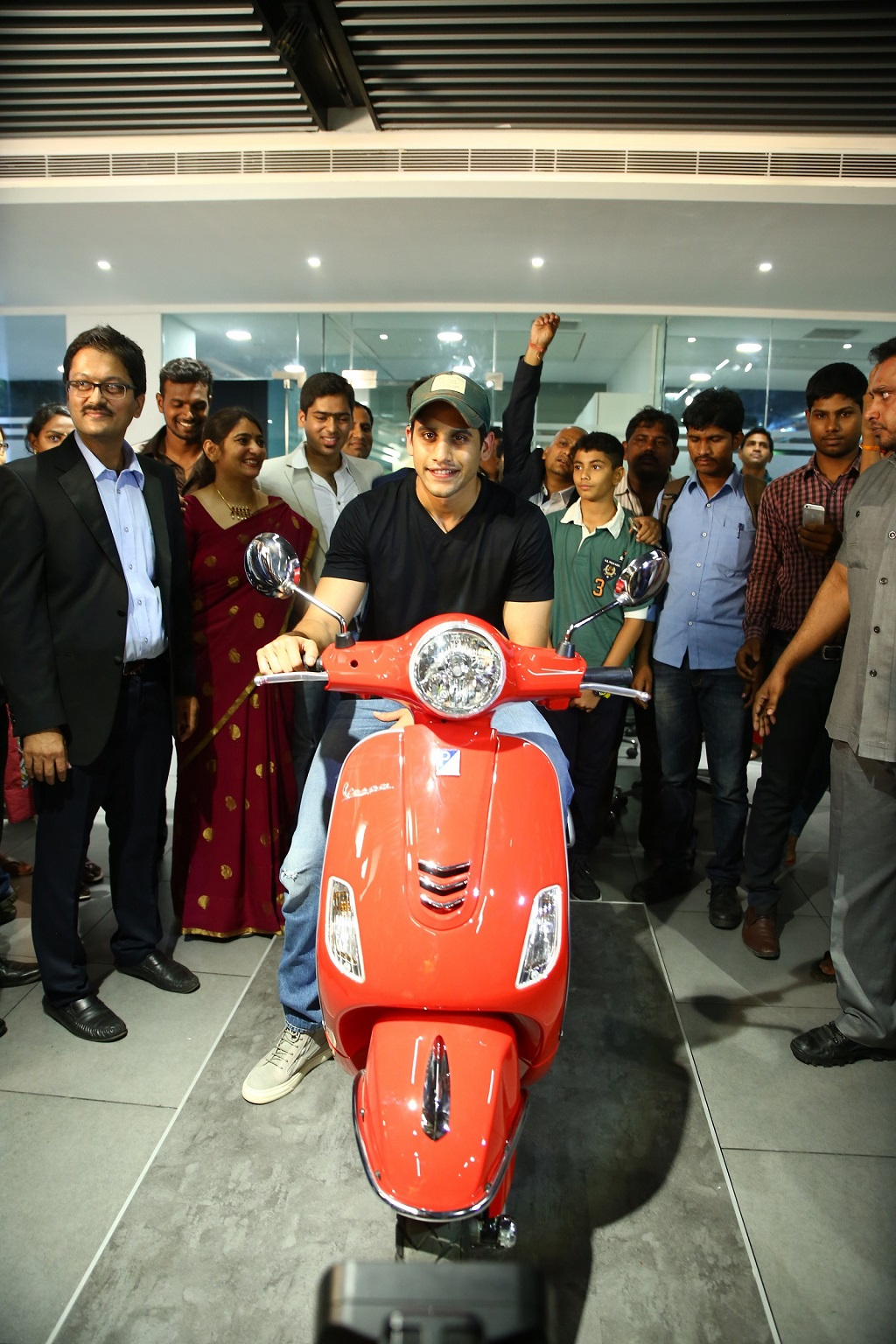 Tollywood heartthrob, Naga Chaitanya on  Red Vespa 150 SXL at the launch of Motoplex - Hyderabad
