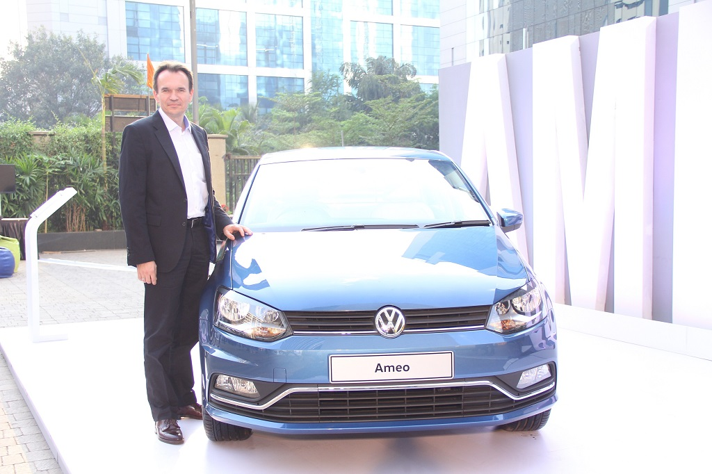 Mr. Michael Mayer, Director, Volkswagen Passenger Cars India with the Ameo at an exclusive showcase of Volkswagen's new carlines in Mumbai