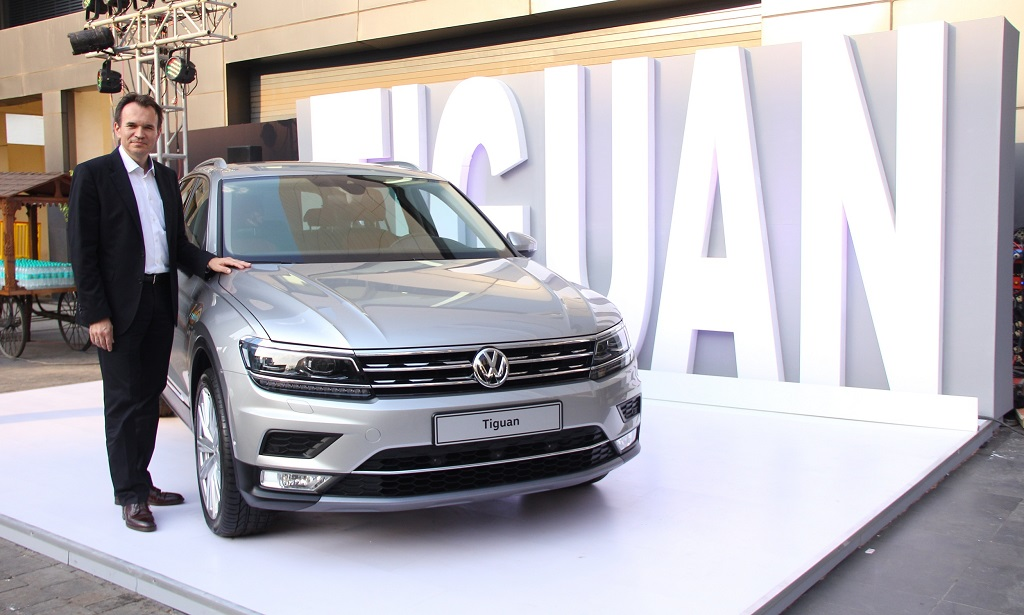 Mr. Michael Mayer, Director, Volkswagen Passenger Cars India with the Tiguan at an exclusive showcase of Volkswagen's 4 new carlines in Mumbai