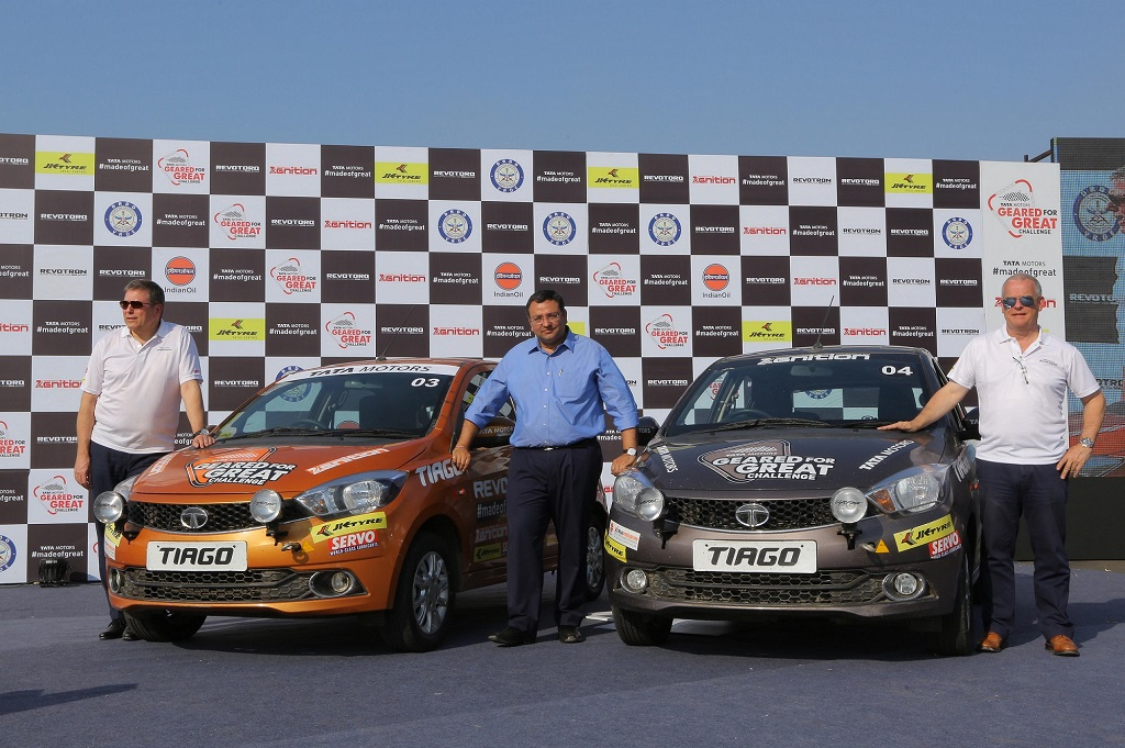Mr. Guenter Butschek, CEO & MD, Tata Motors, Mr. Cyrus P Mistry, Chairman, Tata Sons & Tata Motors, Dr. Tim Leverton, Head – Advanced & Product Engineering, Tata Motors  with the Tata Tiago, after the car achieved a remarkable feat of covering 50,000 km mark.