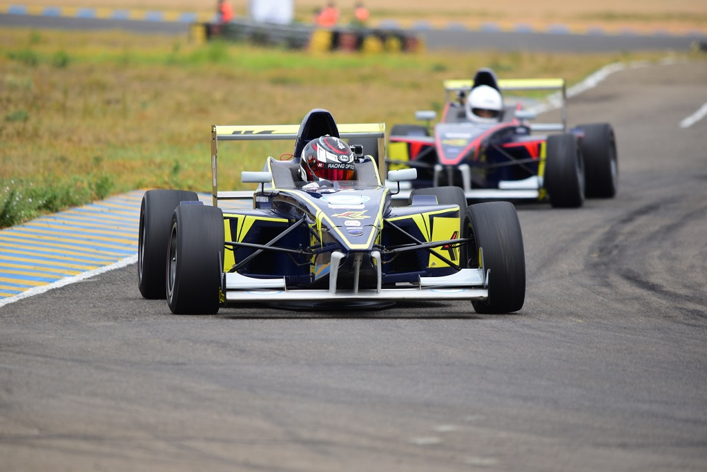 Racers try to edge past each other in Round 1 of the the 19th JK Tyre FMSCI National Racing Championship