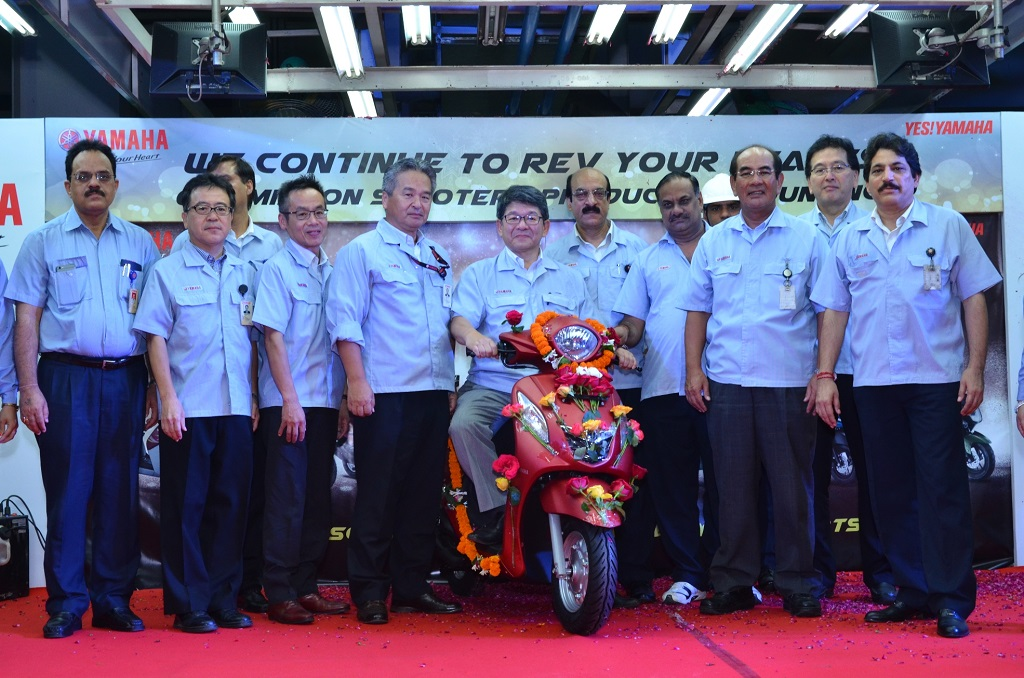 Senior Managent of Yamaha with one- millionth scooter in India