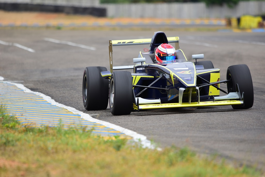 With sight set on the chequered flag racer breezes on his towards the finish line in Round 1 of the 19th JK Tyre FMSCI National Racing Cha