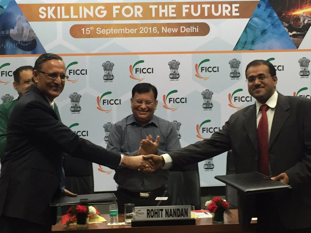 mr-mahesh-rajoria-assistant-vice-president-driving-training-msil-and-mr-amit-jain-president-uber-india-exchange-the-mou-at-the-9th-global-skills-summit-at-ficci