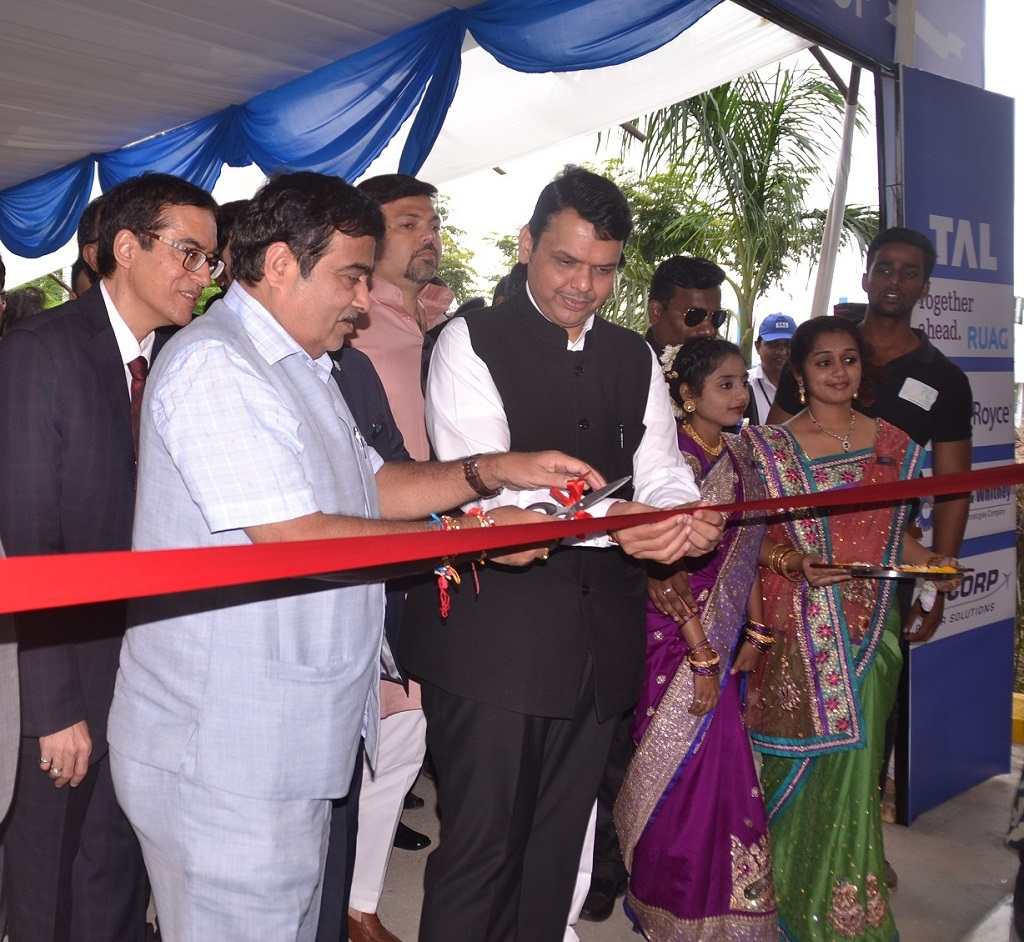 In the image, (Left to Right), Mr. Rajesh Khatri, ED & CEO, TAL Manufacturing Solutions, Shri. Nitin Gadkari, Union Minister for Road Transport, Highways & Shipping and Shri. Devendra Fadnavis, Hon'ble Chief Minister of Maharashtra, at the ribbon cutting ceremony. The celebration was held in the presence of Mr. Guenter Butschek, Managing Director and CEO, Tata Motors & the Board of Directors of TAL, apart from other government and industry dignitaries.